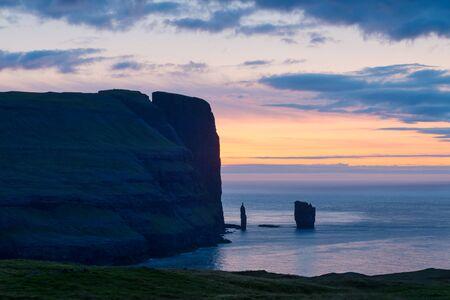 Incredible sunrise morning view on Risin og Kellingin cliffs in Atlantic ocean, Eysturoy island, Faroe Islands, Denmark. Landscape photography