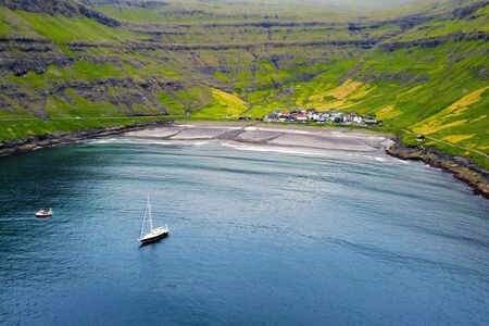 Aerial drone photo flying over Tjornuvik beach on Streymoy island, Faroe Islands, Denmark. Landscape photography Фото со стока