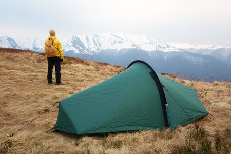 Tourist pitch a tent in spring mountains. Amazing highland. Landscape photography 版權商用圖片