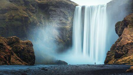 Alone tourist overlooking waterfall at Skogafoss, Iceland Stock fotó