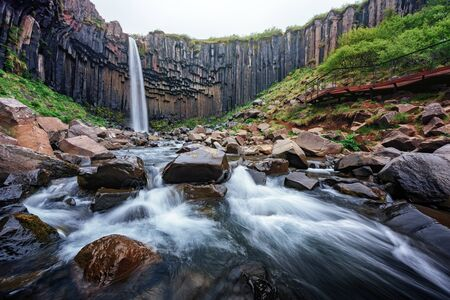 Gorgeous landscape with famous Svartifoss waterfall, another named Black fall. Skaftafell, Vatnajokull National Park, Iceland