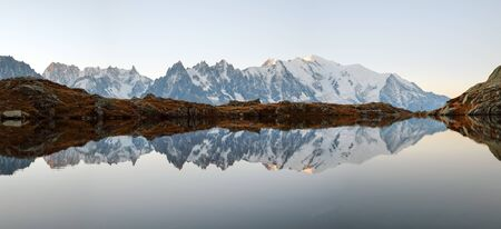 Picturesque panorama of Chesery lake (Lac De Cheserys) and snowy Monte Bianco mountains range on background, Chamonix, France Alps