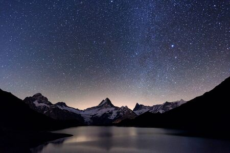 Incredible night view of Bachalpsee lake in Swiss Alps mountains. Stock Photo