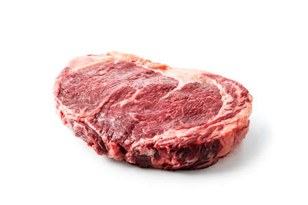 Marbling ribeye steak isolated on white background. Prime rib beef chop. Food photography Standard-Bild
