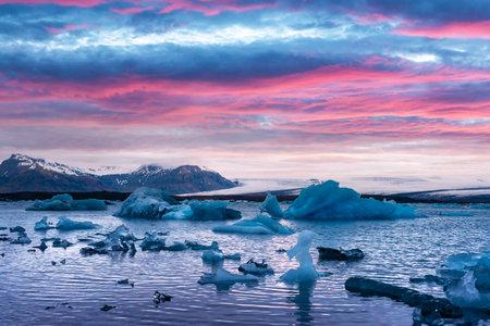 Pink sunset and icebergs in Jokulsarlon glacial lagoon. Vatnajokull National Park, southeast Iceland, Europe. Landscape photography