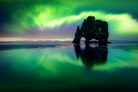 Aurora borealis (Northern lights) over Basalt stack Hvitserkur   Vatnsnes peninsula, Iceland. Landscape photography. Courtesy of . Photo collage
