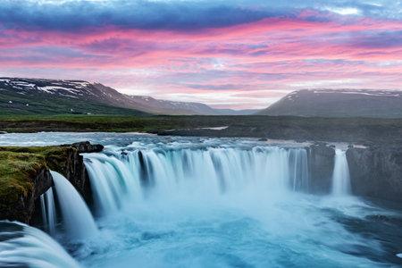 Colorful sunrise on Godafoss waterfall on Skjalfandafljot river, Iceland, Europe. Landscape photography Standard-Bild