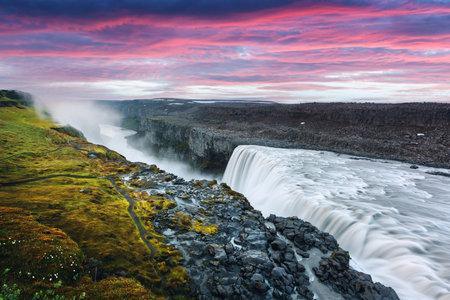 Colorful sunrise on Dettifoss - most powerful waterfall in Europe. Jokulsargljufur National Park, Iceland. Landscape photography Standard-Bild