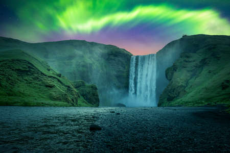 Green aurora light behind famous Skogafoss waterfall on Skoga river. Iceland, Europe. Courtesy of NASA. Photo collage
