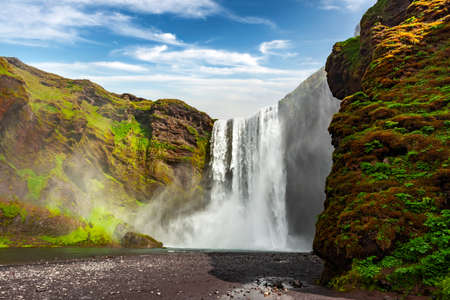 Incredible view on famous Skogafoss waterfall on Skoga river. Iceland, Europe. Landscape photography