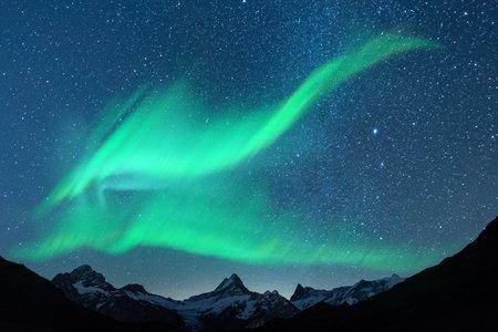 Aurora borealis. Northern lights in winter mountains. Sky with polar lights and stars Standard-Bild