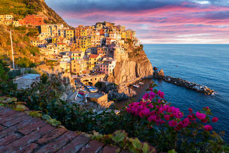 Fantastic landscape of Manarola city with costal rocks on a foreground. Cinque Terre National Park, Liguria, Italy, Europe