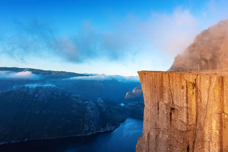 Misty morning on Preikestolen (pulpit-rock) - famous tourist attraction in the municipality of Forsand in Rogaland county, Norway. Landscape photography Standard-Bild