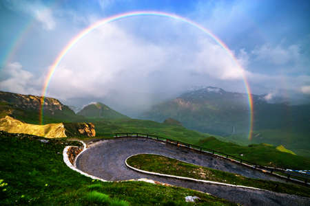 Amazing rainbow on the top of Grossglockner pass, Swiss Alps, Switzerland, Europe. Landscape photography Standard-Bild