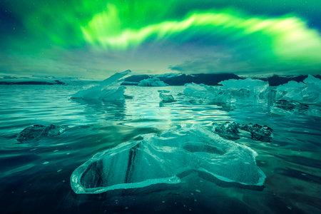 Northern lights over Jokulsarlon Glacial Lagoon, Iceland. Landscape photography. Courtesy of NASA. Photo collage Standard-Bild