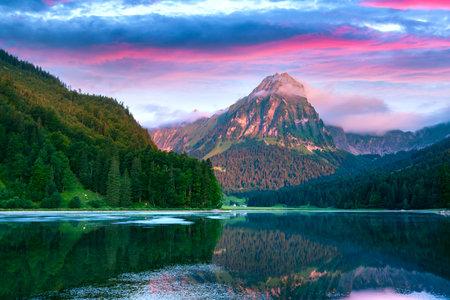 Amazing summer morning on the fantastic Swiss lake Obersee, located near Nafels village. Alps, Switzerland, Europe. Landscape photography Standard-Bild