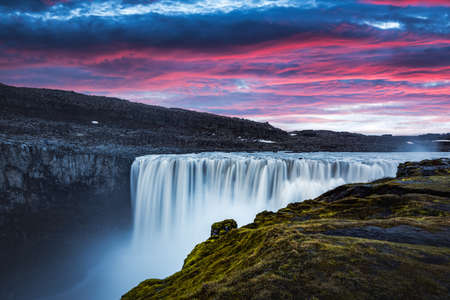 Colorful sunrise on Dettifoss - most powerful waterfall in Europe. Jokulsargljufur National Park, Iceland. Landscape photography Reklamní fotografie