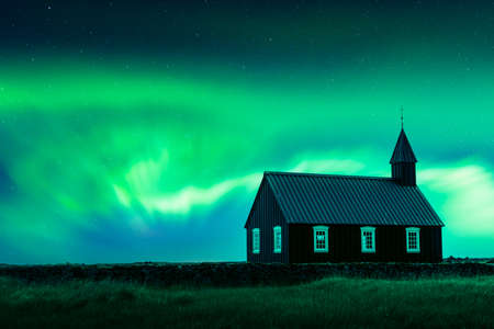 Aurora borealis Northern lights over famous picturesque black church of Budir at Snaefellsnes peninsula region in Iceland. Landscape photography. Courtesy of NASA. Photo collage