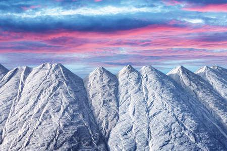 Huge pile of salt against the purple sunset sky Standard-Bild