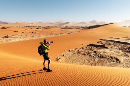 Photographer taking photo in Deadvlei