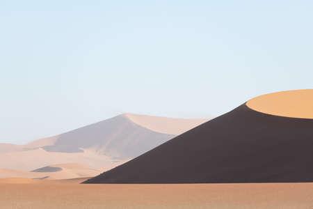 Orange sand dunes and clear sky in Namib desert Standard-Bild