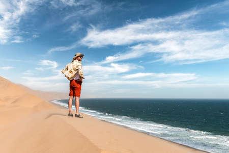Single man in a cowboy hat in the Namib desert