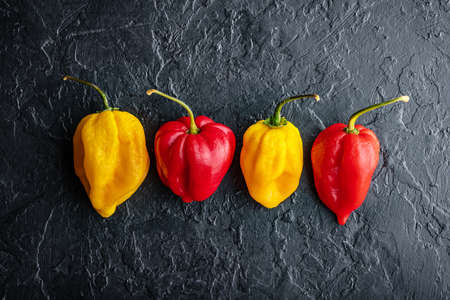 Yellow and red hot peppers jalapeno