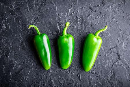 Green jalapeno hot pepper in wooden plate 版權商用圖片