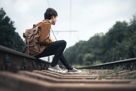 Photographer in brown jacket with backpack 版權商用圖片