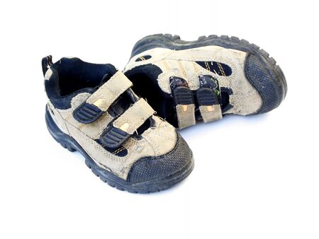 wornout: childs used or worn shoes,isolated Stock Photo