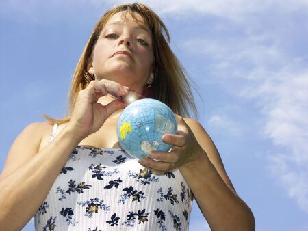 shutting: woman with remote control shutting off world