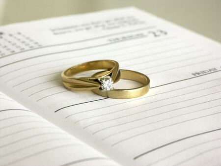 date book: set of wedding rings on a date book ,shallow dof Stock Photo
