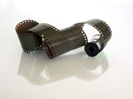 sprockets: twisted film,with canister and reflection