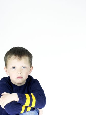 room for text: little five year old with a streight face ,isolated and room for text