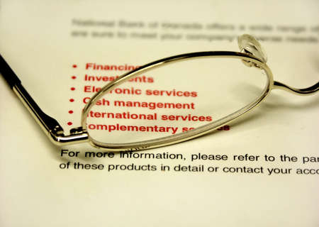 accounts payable: bank book and glasses