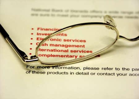 payable: bank book and glasses