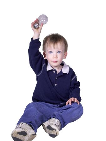 solver: toddler boy with big blue eyes holding up a lightbulb,showing he has an idea