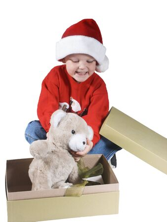 '5 december': child opening a present and happy