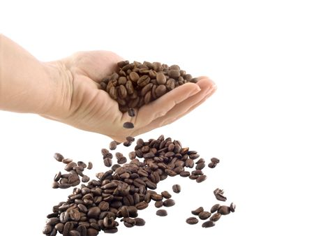 perk: isolated hand and coffee beans