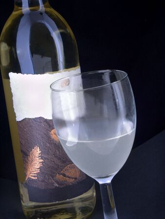 wine bottle and coldfrosted glass 写真素材