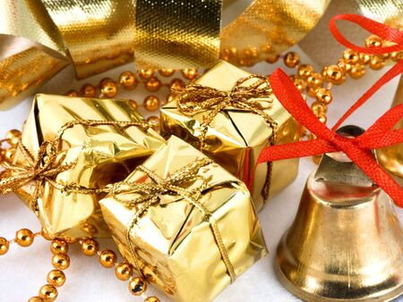 golden presents and bell with ribbon background Stock Photo - 295907