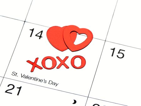 date: valentines date on calender with xoxo and hearts,shallow dof Stock Photo