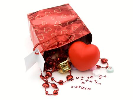 isolated gift bag and presents with xoxo and hearts,shallow dof photo