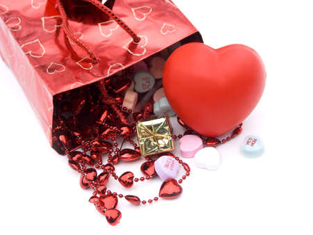 xoxo: isolated gift bag and presents with xoxo and hearts,shallow dof,close-up