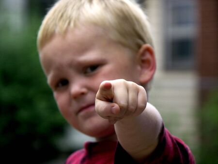 child pointing ,focus on finger photo