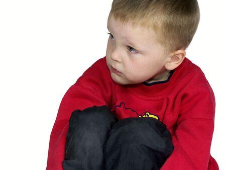 isolated child thinking ,looking sad Stock Photo