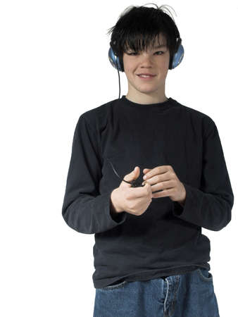 preteen boy: isolated teen listing to music holding mp3