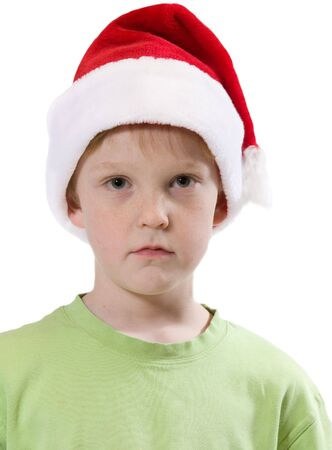 child with santa hat and expression photo