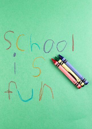 grade school: Grade school writing with crayons - Education is fun. Stock Photo