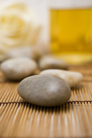 Zen stones and Bottle with aromatic oil soap  for wellness  Stock Photo
